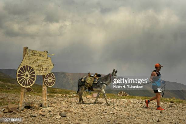 Joe Polonsky of Palmer Lake leads his donkey Jake around the sign at the top of Mosquito Pass as they take part in the 70th annual World Championship...