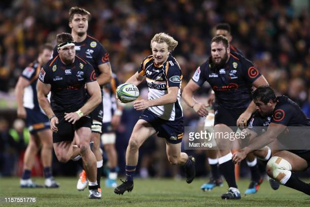 Joe Powell of the Brumbies makes a break to score a try during the Super Rugby Quarter Final match between the Brumbies and the Sharks at GIO Stadium...