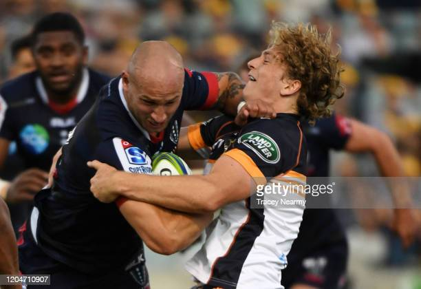 Joe Powell of the Brumbies tackles Billy Meakes of the Rebels during the round 2 Super Rugby match between the Brumbies and the Rebels at GIO Stadium...