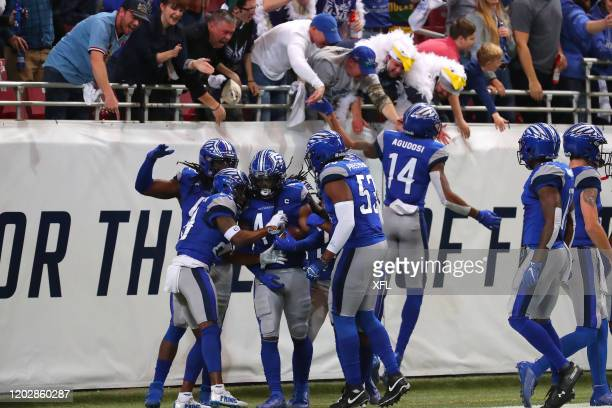 Joe Powell of the St Louis BattleHawks celebrates with his teammates after scoring the first kick return touchdown in XFL history during the game...