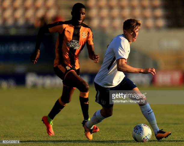 Joe Pritchard of Tottenham Hotspur and Emmanuel Osadebe of Cambridge United compete for the ball during the pre season friendly match between...