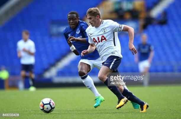 Joe Pritchard of Tottenham Hotspur controls the ball from Dennis Adeniran of Everton during the Premier League 2 match between Everton and Tottenham...