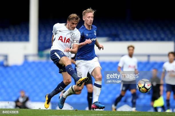 Joe Pritchard of Tottenham Hotspur shoots at goal under pressure from Harry Charsley of Everton during the Premier League 2 match between Everton and...