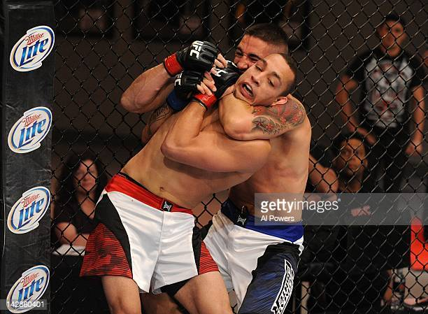 Joe Proctor attempts to submit Chris Tickle during season fiteen of The Ultimate Fighter at the UFC Training Center on April 13, 2012 in Las Vegas,...
