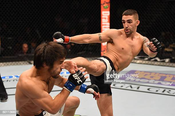 Joe Proctor kicks Magomed Mustafaev of Russia in their lightweight bout during the UFC 194 event inside MGM Grand Garden Arena on December 12 2015 in...