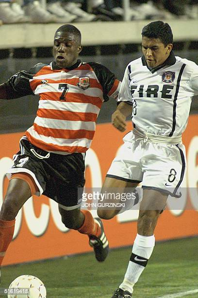 Joe Public's Stokely Mason, of Trinidad and Tobago, battles for the ball against Chicago Fire's Diego Gutierrez of the US, during the first half of...