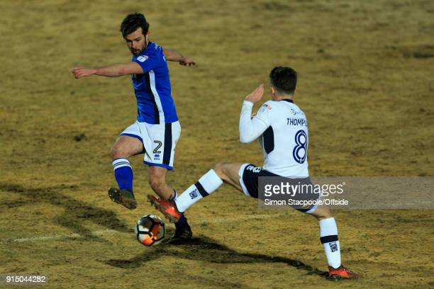 Joe Rafferty of Rochdale battles with Ben Thompson of Millwall during The Emirates FA Cup Fourth Round Replay match between Rochdale AFC and Millwall...