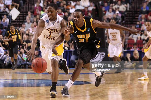 Joe Ragland of the Wichita State Shockers and Treveon Graham of the Virginia Commonwealth Rams battle for the ball in the second half in the second...