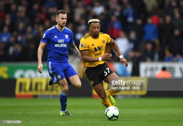 Joe Ralls of Cardiff City and Adama Traore of Wolverhampton Wanderers during the Premier League match between Wolverhampton Wanderers and Cardiff...