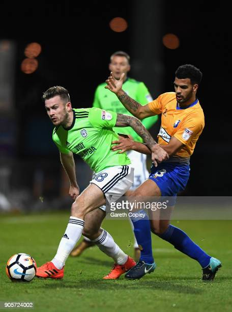 Joe Ralls of Cardiff City and Jacob Mellis of Mansfield Town battle for the ball during The Emirates FA Cup Third Round Replay match between...