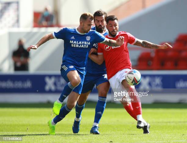 Joe Ralls of Cardiff City battles for possession with Miguel Angel Guerrero of Nottingham Forest during the Sky Bet Championship match between...