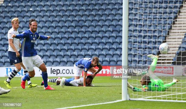 Joe Ralls of Cardiff City beats the dive of Declan Rudd of Preston North End with a header to score the opening goal during the Sky Bet Championship...