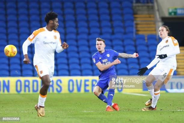 Joe Ralls of Cardiff City clears the ball under pressure from Jackson Irvine of Hull City during the Sky Bet Championship match between Cardiff City...