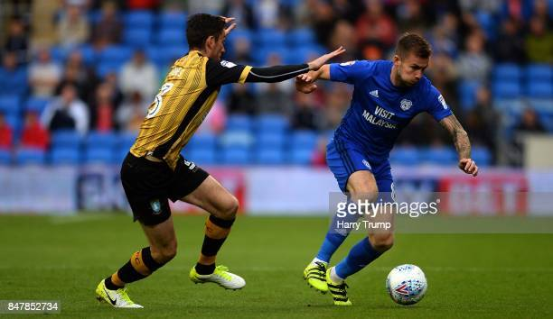 Joe Ralls of Cardiff City is tackled by David Jones of Sheffield Wednesday during the Sky Bet Championship match between Cardiff City and Sheffield...