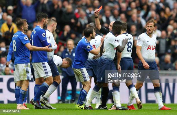 Joe Ralls of Cardiff City receives a red card from match referee Mike Dean during the Premier League match between Tottenham Hotspur and Cardiff City...
