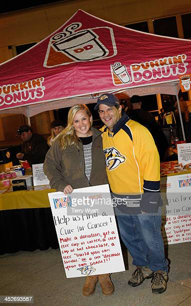 Joe Rando of Dunkin' Donuts and Ellen Mundy with the T.J. Martell Foundation attend the Dunkin' Donuts Nashville Predators Thanksgiving Weekend Plaza...