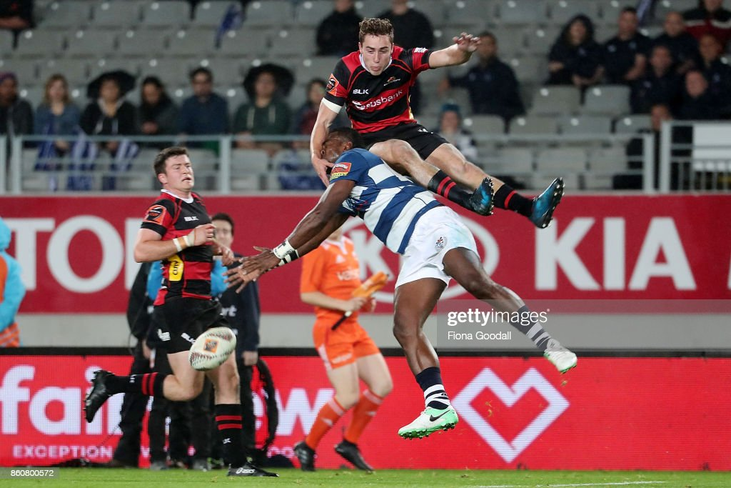 Joe Ravouvou of Auckland goes for the high ball with Josh McKay of Canterbury (R) during the round nine Mitre 10 Cup match between Auckland and Canterbury at Eden Park on October 13, 2017 in Auckland, New Zealand.