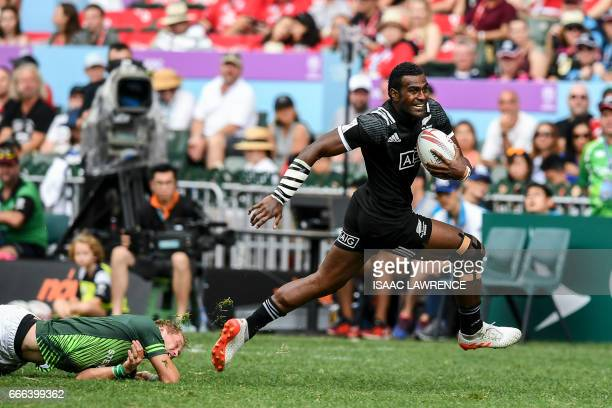 Joe Ravouvou of New Zealand runs the ball during a match against South Africa on the third day of the Hong Kong Rugby Sevens Tournament on April 9...