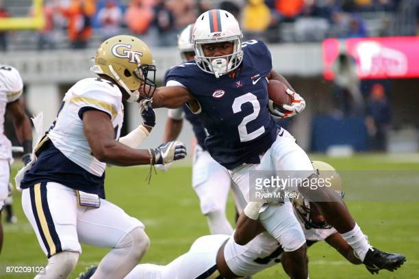 Joe Reed of the Virginia Cavaliers stiffarms Lance Austin of the Georgia Tech Yellow Jackets in the first quarter during a game at Scott Stadium on...