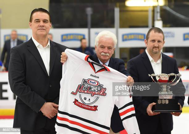 Joe Reekie of the NHLPA rink owner Jim Murphy and Jamison Roth head of the LOC look look on during the Hockeyville trophy presentation prior to the...