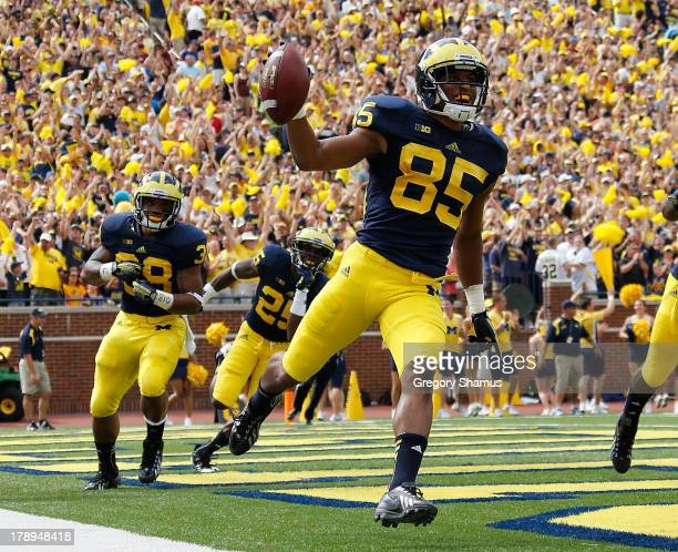 Joe Reynolds of the Michigan Wolverines celebrates returning a first quarter blocked punt for a touchdown while playing the Central Michigan...