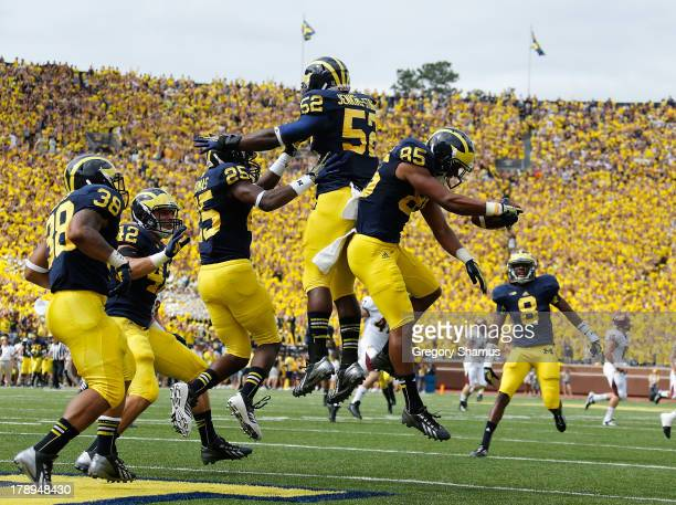 Joe Reynolds of the Michigan Wolverines celebrates with Dymonte Thomas after returning a first quarter blocked punt for a touchdown while playing the...