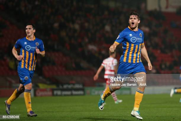 Joe Riley of Shrewsbury Town celebrates after scoring a goal to make it 11 during the Sky Bet League One match between Doncaster Rovers and...