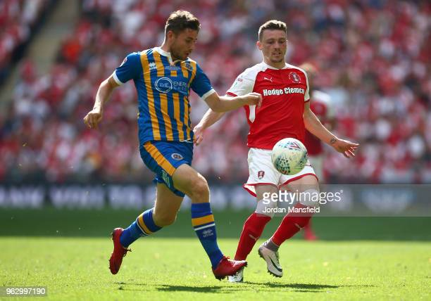 Joe Riley of Shrewsbury Town clears from Caolan Lavery of Rotherham United during the Sky Bet League One Play Off Final between Rotherham United and...