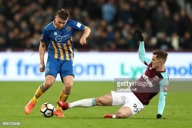 Joe Riley of Shrewsbury Town is tackled by Antonio Martinez Lopez of West Ham United during The Emirates FA Cup Third Round Replay match between West...