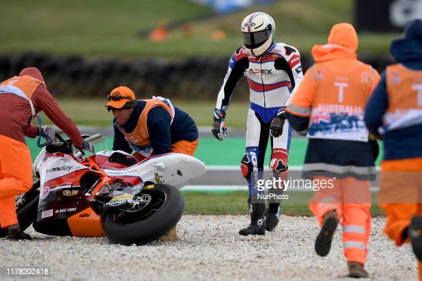 Joe Roberts of USA falls off the Italtrans Racing Team bike during Moto2 practice ahead of the Australian MotoGP at the Phillip Island Grand Prix...