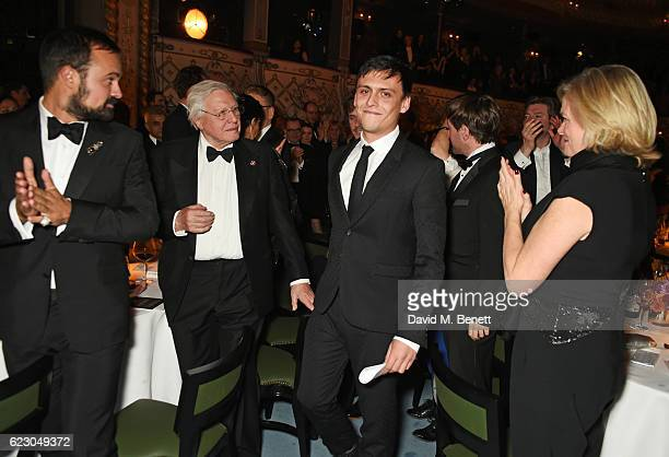 Joe Robertson , winner of the Editor's Award, walks to the stage to accept his award as Evgeny Lebedev, Sir David Attenborough and Ruth Kennedy look...