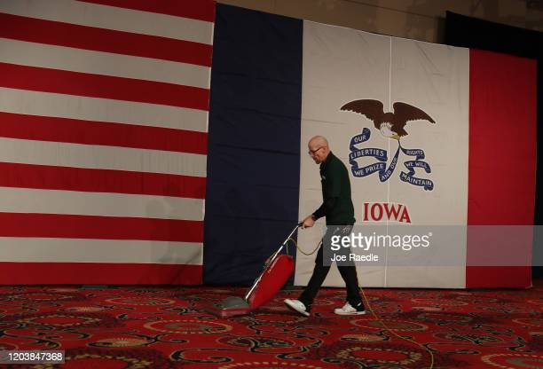 Joe Robinson vacuums the carpet before the start of the caucus night celebration party for Democratic presidential candidate Sen Bernie Sanders at...