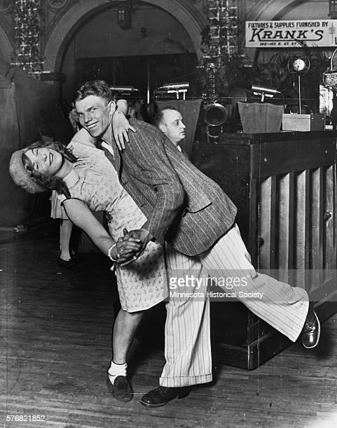 Joe Rock and Marie Goldilocks Rice compete in a 700 hour dance marathon at St Paul Auditorium in 1929 St Paul Minnesota