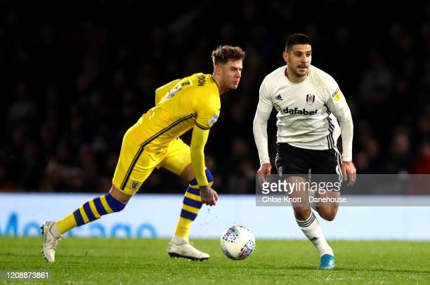 Joe Rodon of Swansea City and Aleksandar Mitrovic of Fulham FC in action during the Sky Bet Championship match between Fulham and Swansea City at...