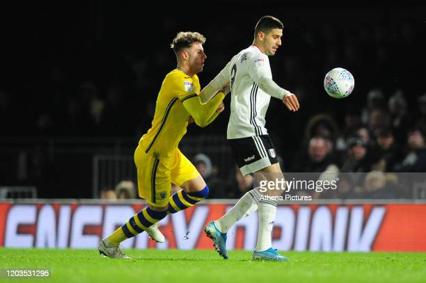 Joe Rodon of Swansea City battles with Aleksandar Mitrovi of Fulham during the Sky Bet Championship match between Fulham and Swansea City at Craven...