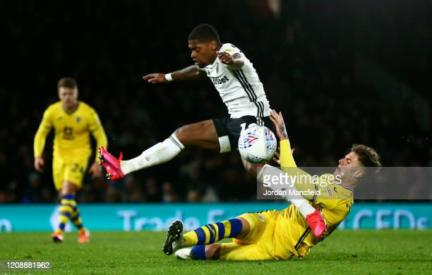 Joe Rodon of Swansea City is challenged by Ivan Cavaleiro of Fulham during the Sky Bet Championship match between Fulham and Swansea City at Craven...
