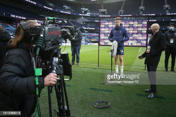 Joe Rodon of Tottenham Hotspur is interviewed after the final whistle during the Premier League match between Tottenham Hotspur and Manchester United...