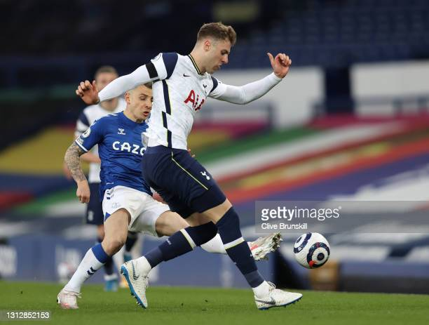 Joe Rodon of Tottenham Hotspur makes a pass whilst under pressure from Lucas Digne of Everton during the Premier League match between Everton and...