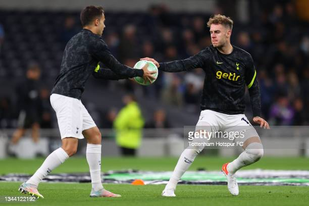 Joe Rodon of Tottenham Hotspur warms up with teammate Sergio Reguilon prior to the UEFA Europa Conference League group G match between Tottenham...