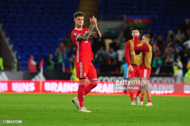 Joe Rodon of Wales applauds the fans at the final whistle during the UEFA Euro 2020 Qualifier match between Wales and Azerbaijan at the Cardiff City...