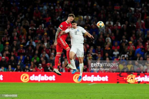 Joe Rodon of Wales vies for possession with Ramil Sheydayev of Azerbaijan during the UEFA Euro 2020 Qualifier match between Wales and Azerbaijan at...
