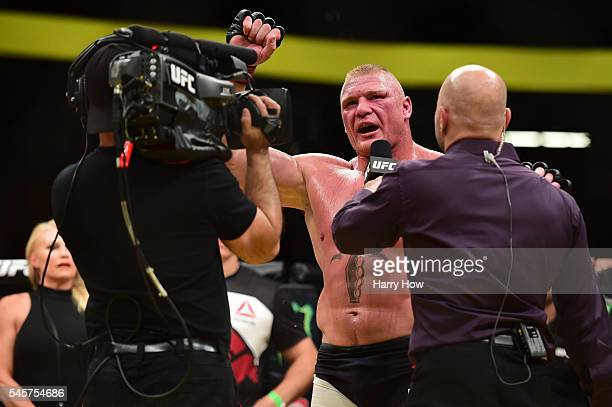 Joe Rogan interviews Brock Lesnar after his victory over Mark Hunt in their heavyweight bout during the UFC 200 event on July 9 2016 at TMobile Arena...