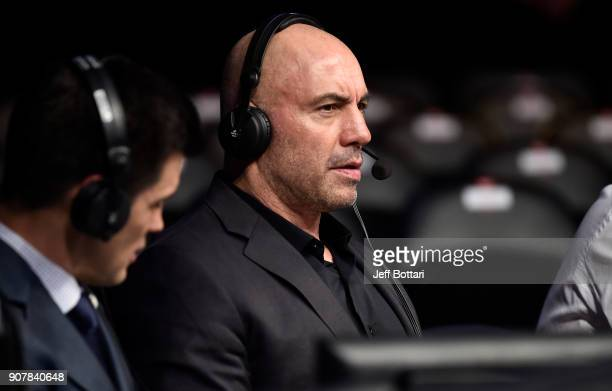 Joe Rogan is seen in the commentary booth during the UFC 220 event at TD Garden on January 20 2018 in Boston Massachusetts