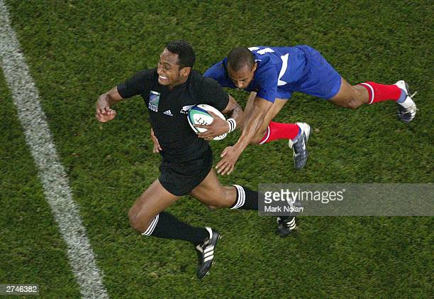 Joe Rokocoko of New Zealand in action during the Rugby World Cup Play Off match between France and New Zealand at Telstra Stadium November 20 2003 in...