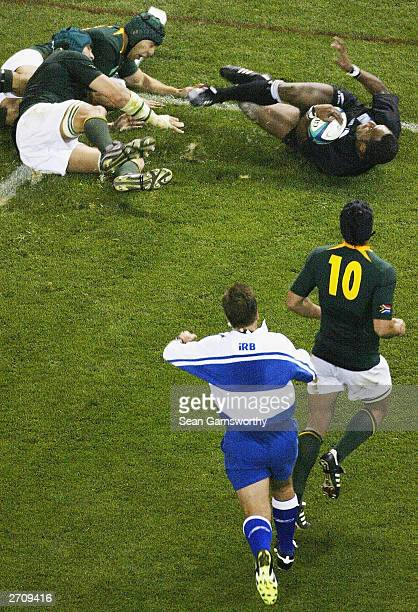Joe Rokocoko of New Zealand scores a try during the Rugby World quarter final 1 between New Zealand and South Africa at the Telstra Dome November 8...
