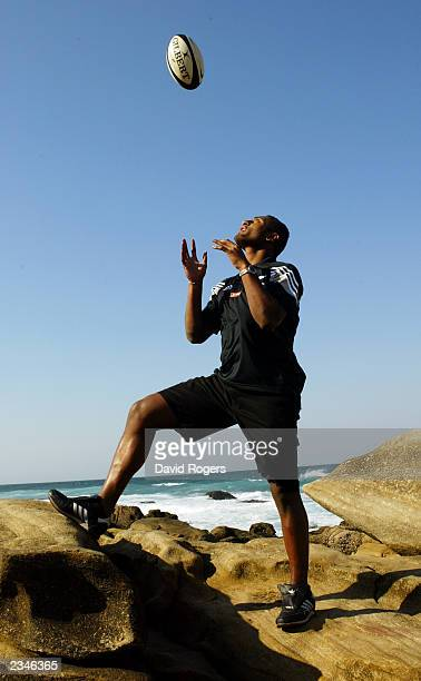 Joe Rokocoko of New Zealand throws the ball in the air during a photo shoot on July 17 2003 at Umhlanga Rocks in Durban South Africa