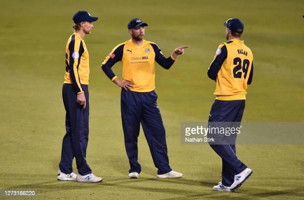 Joe Root, Adam Lyth and Dawid Malan of Yorkshire Vikings discuss tactics during the T20 Vitality Blast 2020 match between Lancashire Lightning and...