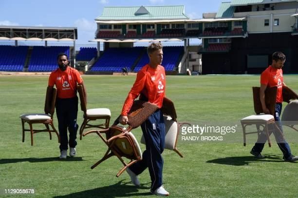 Joe Root and Adil Rashid of England take chairs off the field during a training day ahead of the 2nd T20 between the West Indies and England at...