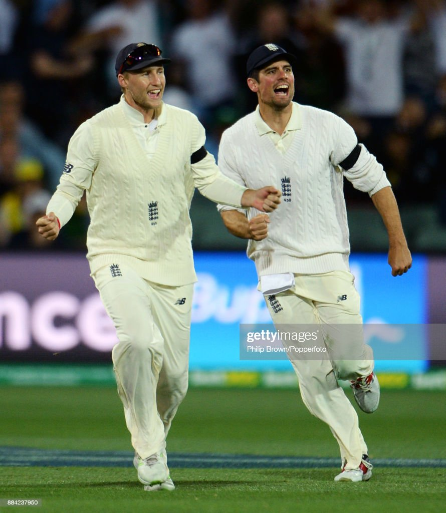 Joe Root and Alastair Cook of England celebrate after Steve Smith of Australia was dismissed during the first day of the second Ashes cricket test match between Australia and England at the Adelaide Oval on December 2, 2017 in Adelaide, Australia.