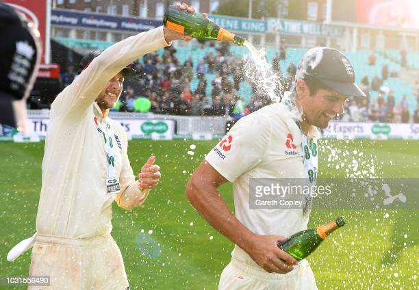 Joe Root and Alastair Cook of England celebrates winning the Specsavers 5th Test match between England and India at The Kia Oval on September 11 2018...
